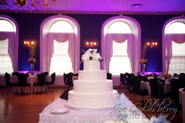 Ericka & Mark's wedding cake took center stage with uplighting enhancement.