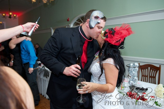 The groom changed from his Navy uniform to a smart black suit for a New Years kiss with his new wife.