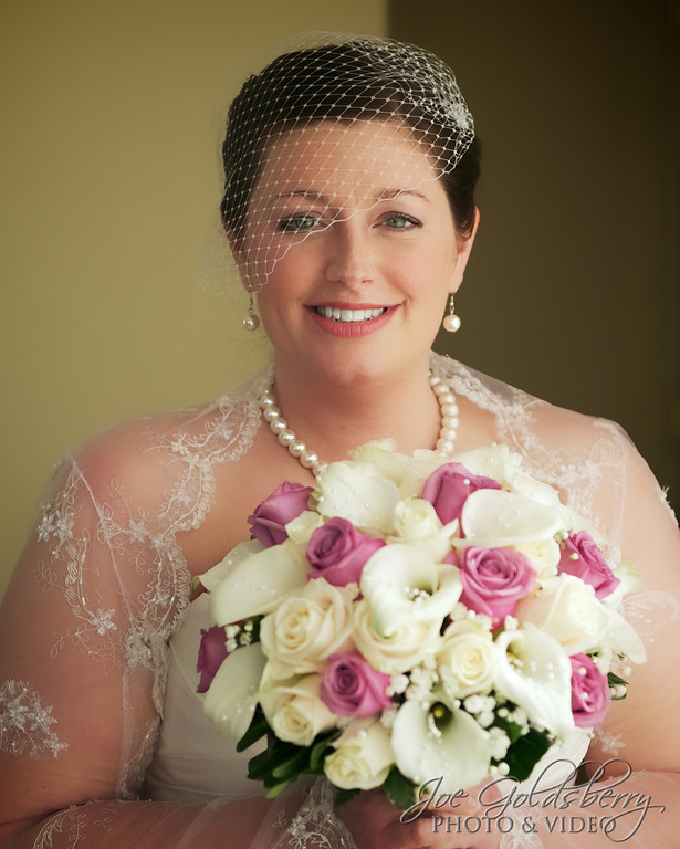 Leah makes a stunning bride. Bouquet by Barry's Flowers.