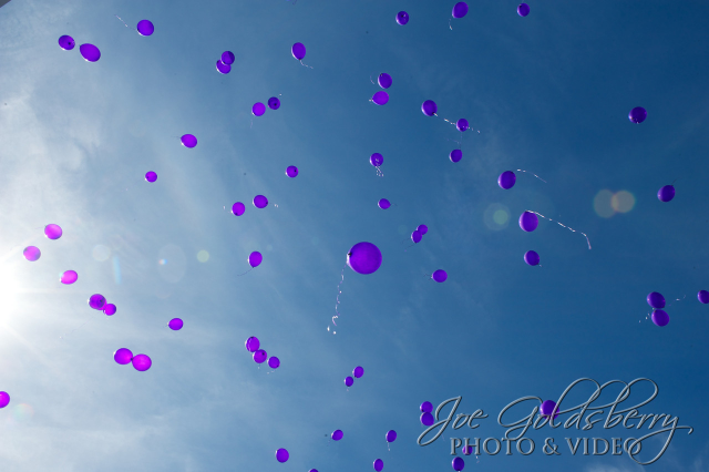 Purple balloons being sent up to Rachel and Lillian Rose.